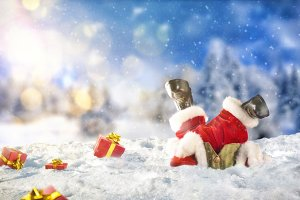 Santa claus fallen face down on snow