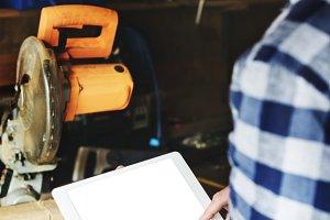 repair man working on tablet (PNG)