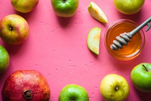Frame of apples, pomegranate and honey for the Rosh Hashanah