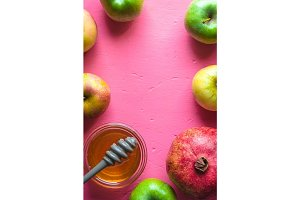 Frame of apples, pomegranate and honey for the Jewish New Year