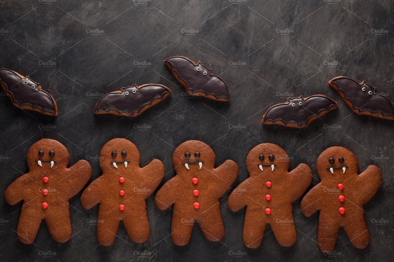 Homemade gingerbread cookies for Halloween in the form of bats and  gingerbread men vampire on dark concrete background. Top view |  High-Quality Holiday Stock Photos ~ Creative Market