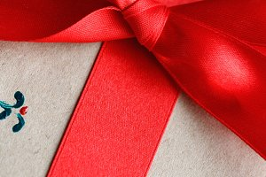 Close-up of a red bow on a gift box. Christmas concept.