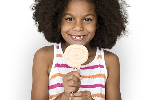 Girl Eating Lollipop Smiling (PNG)