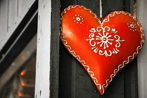 Christmas heart on old wooden house