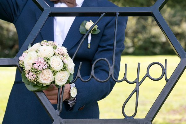 Groom Holding a Wedding Bouquet