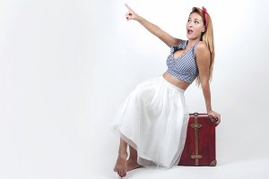 beautiful young girl with suitcase