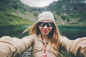 Woman traveler taking selfie