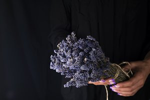 woman creating bouquet of natural lavender flowers,