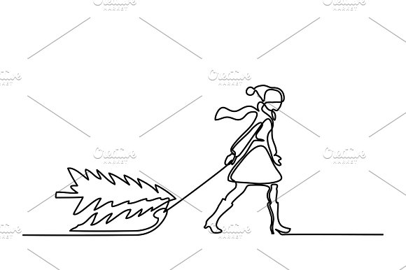 Woman with christmas tree on sled