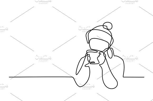 Woman drinking tea winter time
