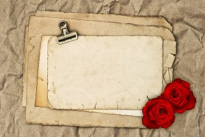 Papers and rose flowers