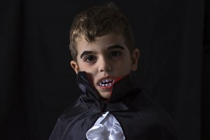 Boy disguised as a vampire.