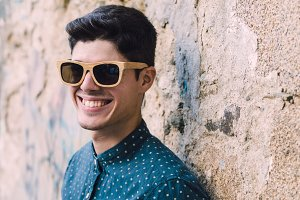 Model man with sunglasses smiling