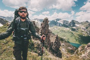 Man traveler hiking with backpack