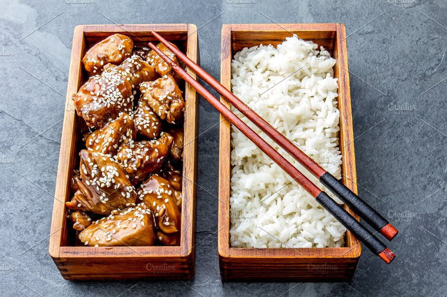 Japanese Food Chicken Teriyaki With Rice In Wooden Bento Lunch Box Slate Background Top View