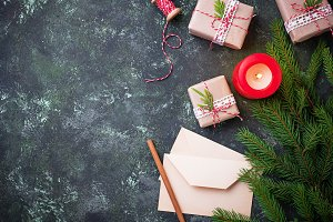 Christmas background. Gift boxes, letter and candle