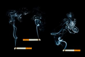 Three smoking cigarette