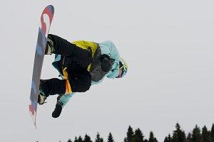 Snowboarder in flight.
