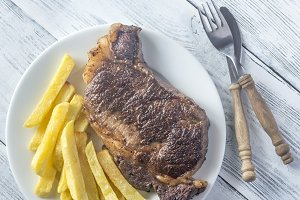 Beef steak with fried potatoes