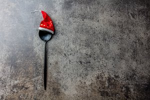 Holiday Christmas food background concept. Christmas menu concept. Cutlery spoon with Christmas decoration, stone background, Copy space