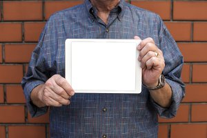 man holding a digital tablet