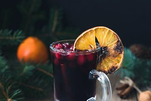 Mulled wine with cranberries and cinnamon in glass