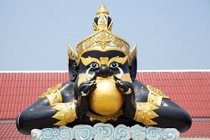 Giant black statue.