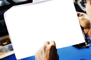 Man holding a blank paper(PNG)