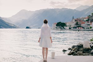bride walking in picturesque bay