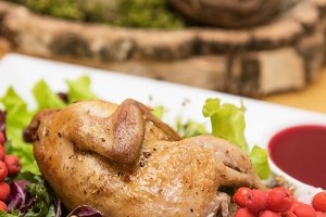 quail roasted with sweet and sour cranberry sauce