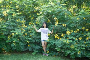 asian girl and yellow flower.
