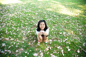 Teenage girl sitting on grass