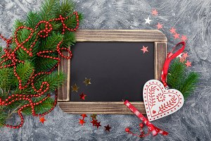 Christmas chalkboard background with decorations and pine tree