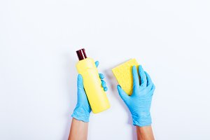Female hands in blue rubber gloves