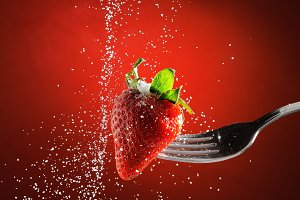 Strawberry on a fork punctured falli