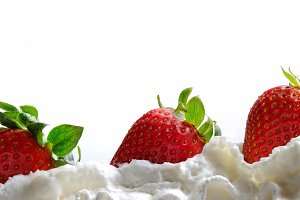 Strawberries with cream isolated