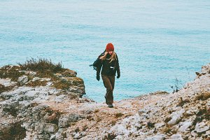 Woman walking alone at cold sea