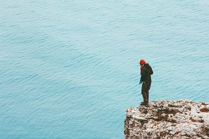 Traveler standing on cliff edge