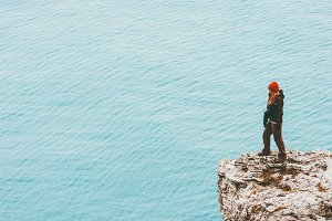 Traveler standing on cliff