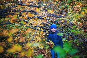 Beauty boy at autumn park