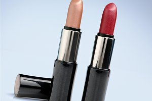 Two red and cream lipsticks