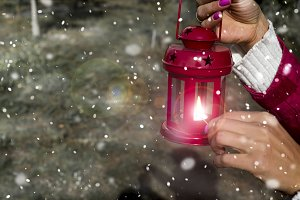 girls lighting a candle Christmas red lantern