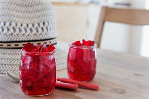 red jelly, cut into dice, inside two glasses of glass