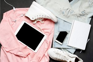 Fashion woman Clothes Set. Black White. Pink blouse, blue jeans, white sneakers, tablet, phone