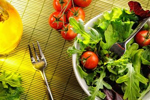 Salad in a bowl on bamboo tablecloth