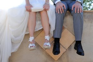 Feet of bride and groom sitting