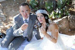 Groom bride  doing soap bubbles