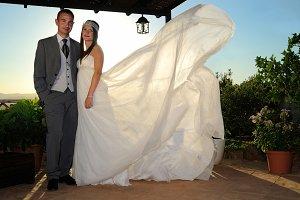 Bride and groom under a porch