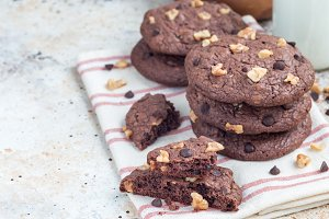 Homemade chocolate cookies with walnuts and chocolate chips on table , horizontal, copy space
