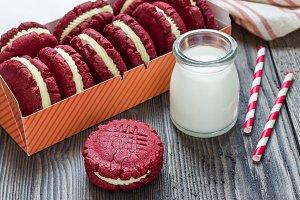 Red velvet sandwich cookies with milk